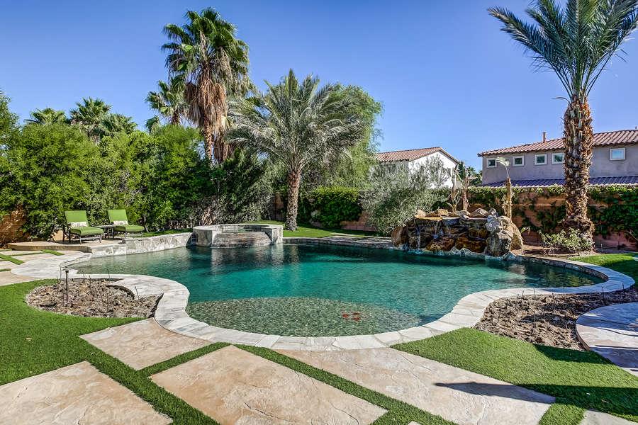 Oversized pool with large tanning shelf