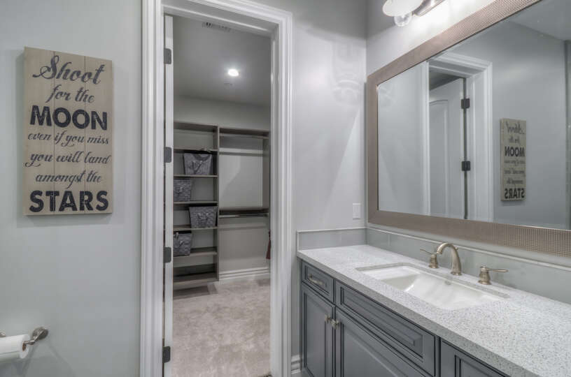 The connected bath and walk-in closet provide ample space to get ready for a night out in the town.
