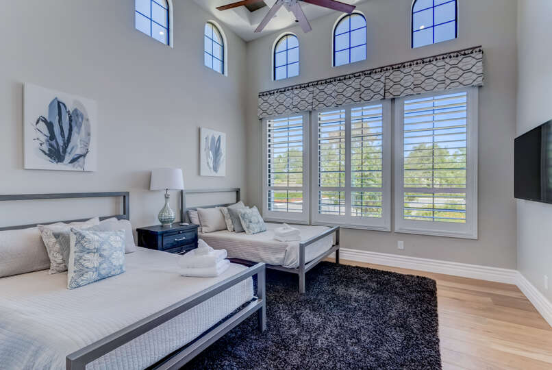 Guest Bedroom 2 has large windows that allow plenty of natural light.