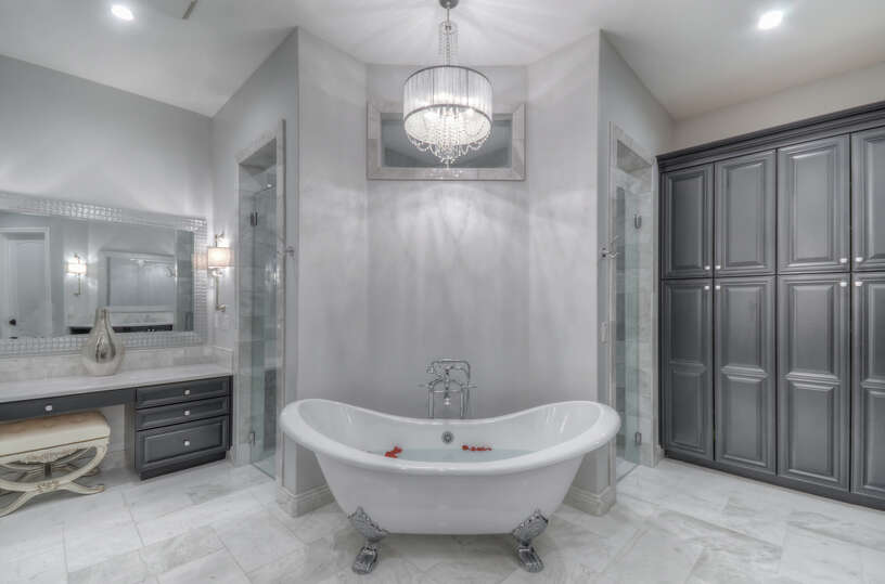 The en-suite master bath is centered around the enormous free-standing bathtub and a dual entry shower.