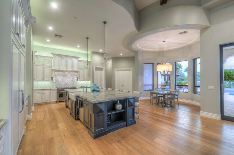 Right behind the living room is an enormous kitchen, the two rooms are seamlessly connected in this open floor plan concept.