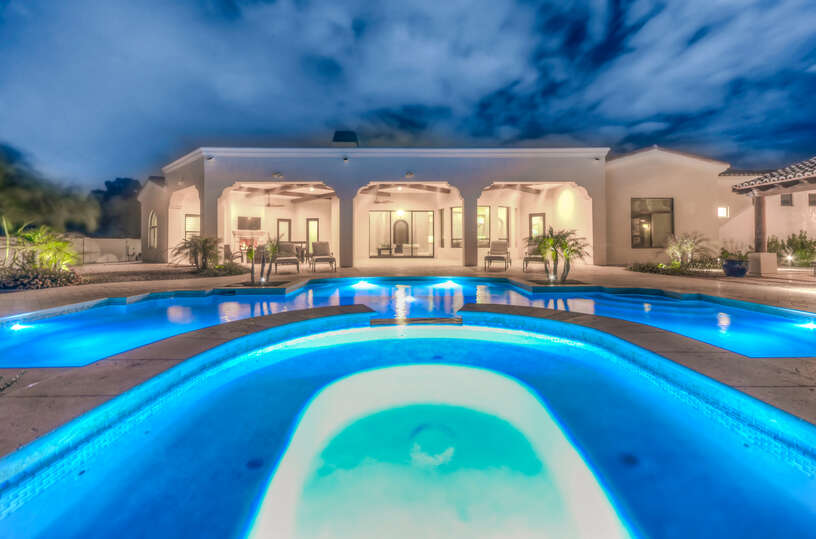 Unwind at night in the Cholla Villa Spa overlooking the pool and the main home.