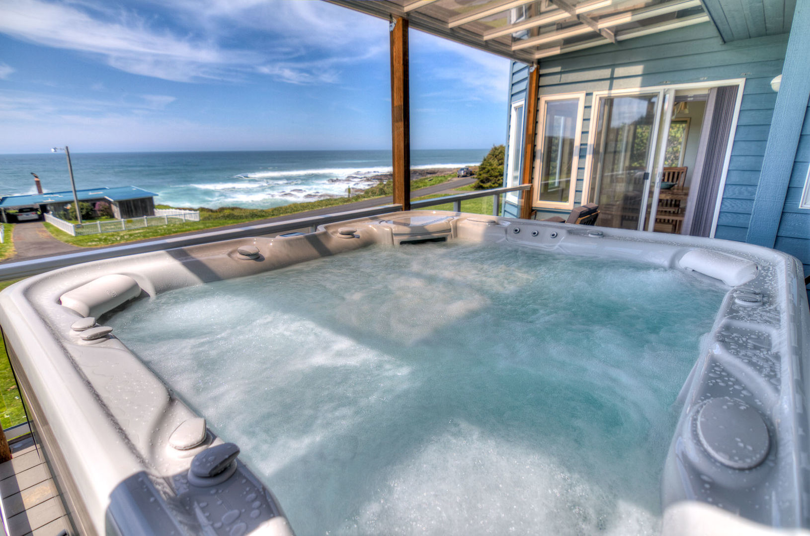Large hot tub with views on the second floor deck.
