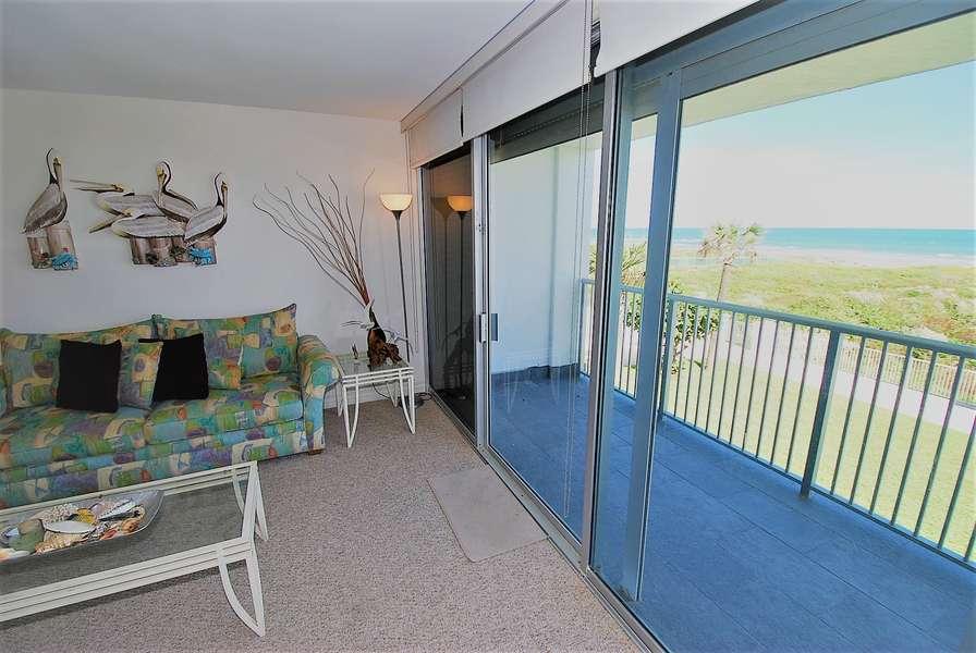 Living room overlooking balcony to beach