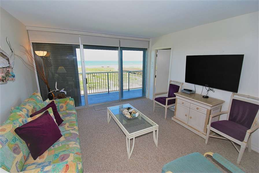 Living room with unobstructed view to the beach