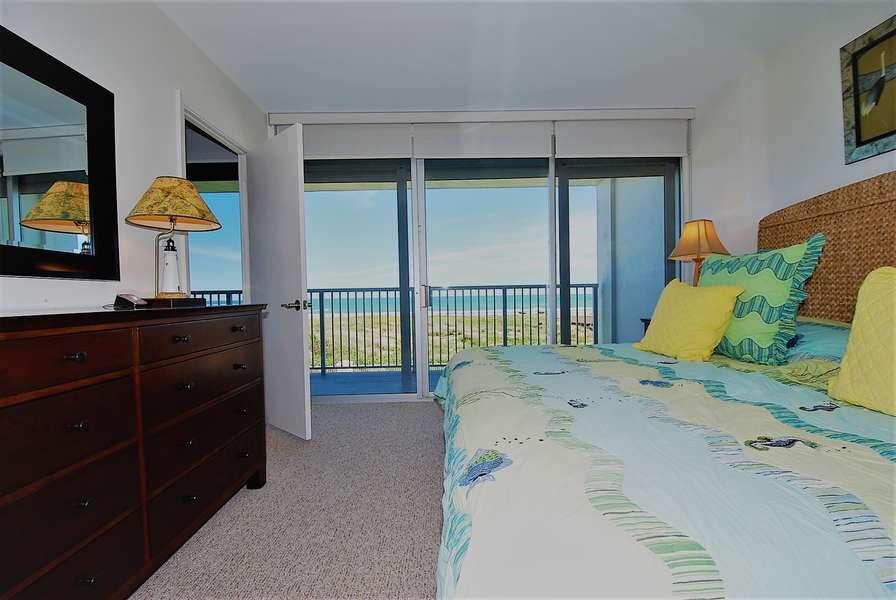 Master bedroom overlooking balcony to beach