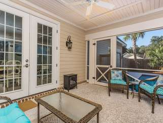 Screened porch with ceiling fan, ample seating for entertainment