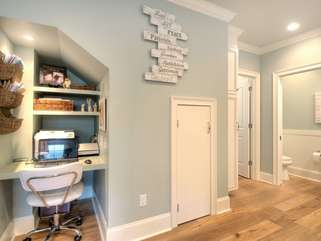 Office nook located off kitchen. Laser printer on site, wifi, USB wall ports