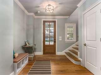 Foyer, large coat closet doubles as extra storage