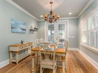 Breakfast/Dining Room off of kitchen with access to screened porch