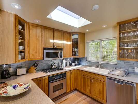 upgraded kitchen! Ample counter space and high-end stainless steel appliances, including a gas range