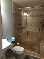 The shared bathroom is conveniently located between the two guest rooms.