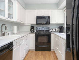 The fully equipped kitchen features Corian counters, Whirpool appliances and a Keurig coffee maker.  Enjoy plenty of counter space for prep work.