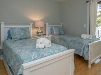 The second guest bedroom features two twin beds plus one trundle.