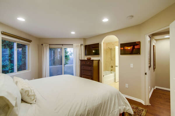 Master bedroom with King bed and flat screen TV