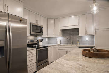 Spectacular renovated kitchen with granite counter tops and stainless steel appliances.