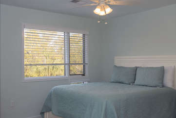 Guest bedroom is full of natural light.