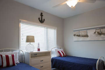 The first floor guest bedroom welcomes you with twin beds and an en suite bathroom.