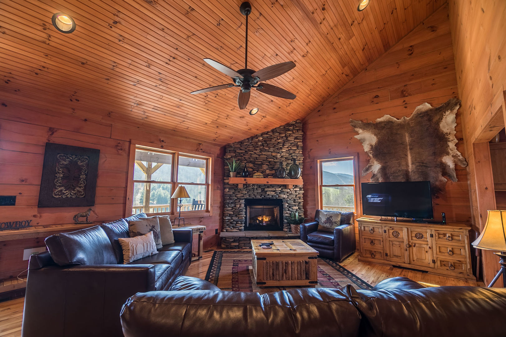 Living area with gas log fireplace, TV and mountain views