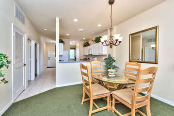 Dining Room with Seating for 4; Enjoy Home Cooked Meals When Staying at this Condo Rental!