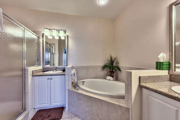 Master Bedroom With Walk In Shower And Spa Tub;
