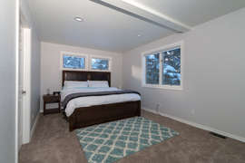 The master bedroom features a comfortable king bed