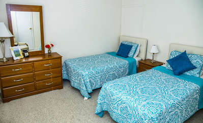two twin beds in second bedroom