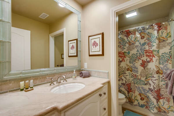 First floor bathroom with tub/shower combo
