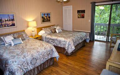 Bedroom with doorway to back deck