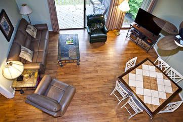 View of the living room and dining area from the loft