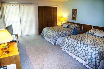 Bedroom with door to back deck