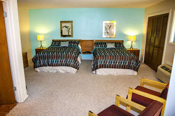 Spacious master bedroom with two full beds