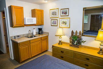 Additionally supplied with mini fridge, sink, coffee maker, microwave, and TV