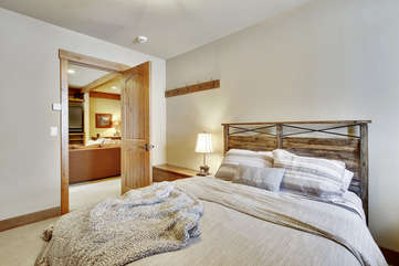 Lower level guest suite with queen bed
