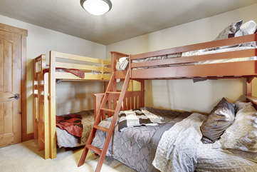 Lower level bunk room with 3 twins and a full size bed