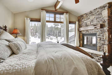 Beautiful upper level master suite with gas fireplace and amazing views