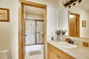 Main level bathroom suite with separate sink area