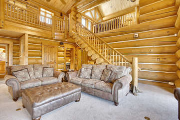 Upper loft area overlooking the great room with custom log steps
