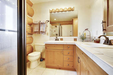 Large upper bathroom with double sinks