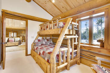 Custom log beds in bunk room