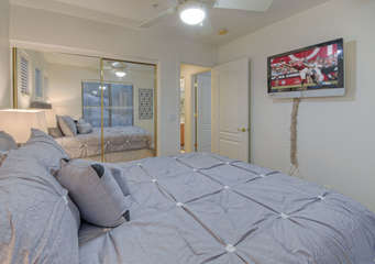 Third bedroom is yet another cozy spot to take a nap or view entertainment of your choice