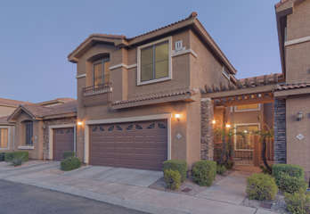 Two story condo in popular Desert Springs Complex includes a 2 car garage for your vehicles and recreational gear