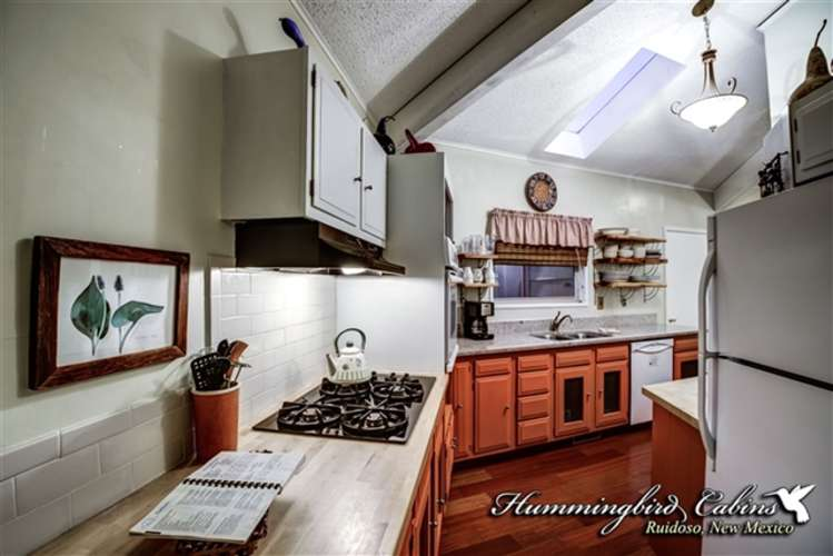 Fully stocked kitchen with pots,pans silverware and the items you would need to prepare meals.