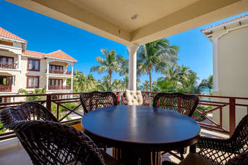 La Beliza 503 veranda 2nd floor view or beach and swaying palms.  Enjoy the warm Caribbean breeze