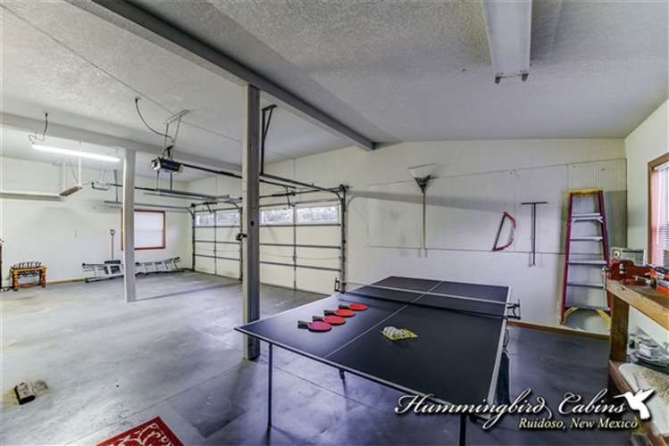 Ping pong table in garage for guest to use