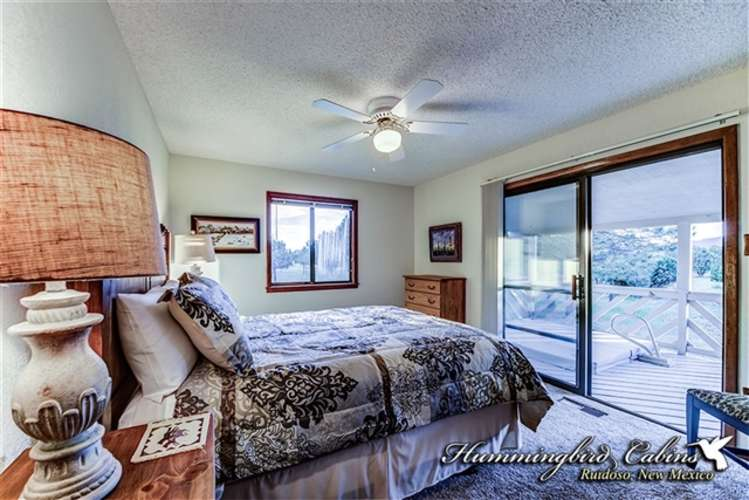 Guest bedroom opens up to small deck