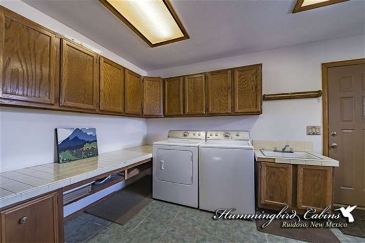 Laundry facilities on main level off kitchen