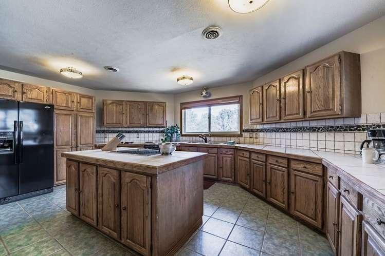 The kitchen features ample counter top space and an island