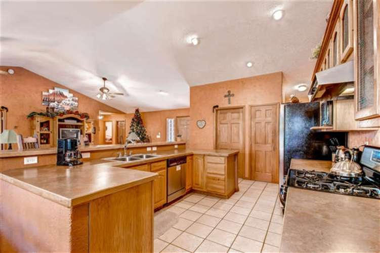 Fully stocked kitchen with stainless steel appliances and regular coffee pot.