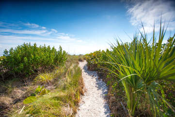 Beautiful sand path steps from the Gulf's turquoise waters